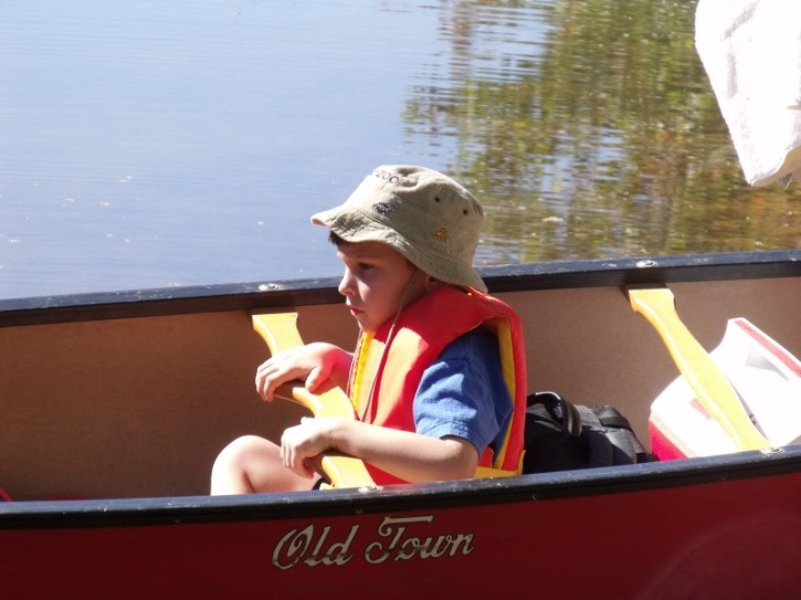 Boy Canoing on Mayo Lake